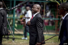 (FILES) In this file photo taken on July 01, 2015 Burundi's President Pierre Nkurunziza gestures as he arrives for celebrations…