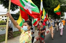 Military supporters wave Myanmar national flags during a protest to demand an inquiry to investigate the Union Election…