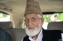 (FILES) In this file photo taken on August 19, 2014 Kashmiri separatist leader Syed Ali Shah Geelani arrives at the Pakistan…
