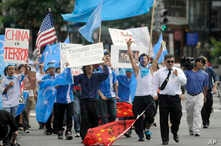Uighur supporters march towards the Chinese Embassy after a Uighur protest rally at Dupont Circle in Washington on Tues. July 7, 2009. Sunday's violence in China's Xinjiang region between Muslim Uighurs and ethnic Han Chinese has killed at least 156…