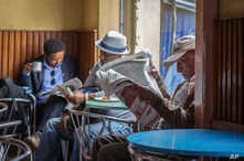 In this Monday, Oct. 10, 2016 file photo, Ethiopian men read newspapers and drink coffee at a cafe during a declared state of emergency in Addis Ababa, EthiopiSince 2015 there have been wide-ranging internet shutdowns.
