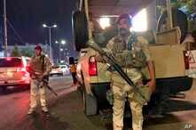 Iraqi security forces stand guard near Bahraini embassy in Baghdad, Iraq, Thursday, June 27, 2019. Protesters stormed the Bahraini embassy compound in Baghdad Thursday night, removing the flag from above the building and replacing it with a…