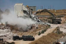 Israeli forces destroy a building in a Palestinian village of Sur Baher, east Jerusalem, Monday, July 22, 2019. Israeli work crews have begun demolishing dozens of Palestinian homes in an east Jerusalem neighborhood. Monday's demolitions cap a years…