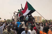Sudanese shout slogans during a demonstration against the military council, in Khartoum, Sudan, Sunday, June 30, 2019. Tens of thousands of protesters have taken to the streets in Sudan's capital and elsewhere in the country calling for civilian…