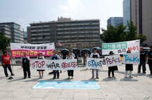 Protesters stand with banners to oppose planned joint military exercises between South Korea and the United States near the U.S. embassy in Seoul, South Korea, Monday, Aug. 5, 2019. The both countries are preparing to hold their annual joint…