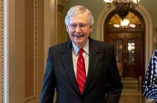 Senate Majority Leader Mitch McConnell, R-Ky., smiles after vote on a hard-won budget deal that would permit the government to resume borrowing to pay all of its obligations and would remove the prospect of a government shutdown in October, at the…