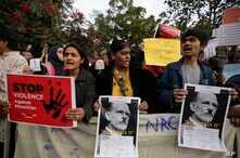 Indians holds placards during a protest against a new citizenship law out side Gandhi Ashram in Ahmadabad, India, Tuesday, Dec…