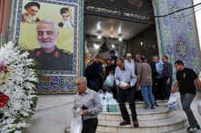 People leave a mosque at the conclusion of a mourning ceremony in a predominantly Iraqi neighborhood, south of Tehran, Iran,…