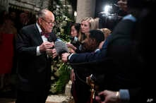 Former New York Mayor Rudy Giuliani, an attorney for President Donald Trump, speaks to reporters as he arrives for a New Year's…