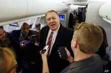 U.S. Secretary of State Mike Pompeo speaks to reporters aboard his plane en route to London, Wednesday Jan. 29, 2020.  Pompeo,…