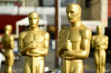 Oscar statues stand off of Hollywood Boulevard in preparation for Sunday's 92nd Academy Awards at the Dolby Theatre, Wednesday,…