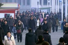 In this image made from video, pedestrians brave the cold as the make their way through an open square, Thursday, Jan. 30, 2020…