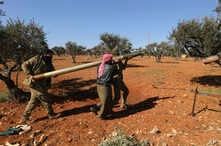 Rebel fighters prepare to fire a missile towards Syrian government positions in the province of Idlib, Sunday, Feb. 9, 2020…