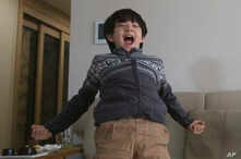 Parasite actor Jeong Hyeonjun celebrates as he watches a TV live broadcasting of South Korean director Bong Joon Ho receiving…