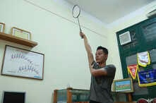In this March 19, 2020, photo, a PE teacher demonstrates a badminton technique to his students during an online class at Nguyen…