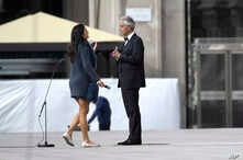 Italian singer Andrea Bocelli talks with his wife Veronica Berti prior to performing outside the Duomo cathedral, on Easter…