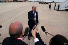 President Donald Trump talks to reporters before boarding Air Force One for a trip to Phoenix to visit a Honeywell plant that…