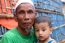 A Rohingya refugee sits with a child at the Kutupalong Rohingya refugee camp in Cox's Bazar, Bangladesh, Tuesday, June 2, 2020…