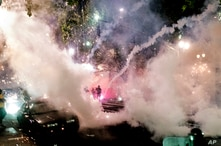 Smoke fills the sky as federal officers try to disperse Black Lives Matter protesters on Wednesday, July 22, 2020, in Portland,…