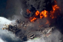 FILE - In an April 21, 2010, file photo taken in the Gulf of Mexico more than 50 miles southeast of Venice, La., the Deepwater…