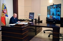 Russian President Vladimir Putin attends a cabinet meeting at the Novo-Ogaryovo residence outside Moscow, Russia, Tuesday, Aug…