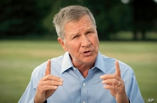 In this image from video, former Republican Ohio Gov. John Kasich speaks during the first night of the Democratic National…