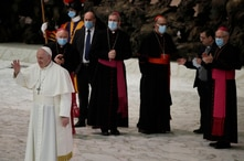Pope Francis waves to faithful at the end of the weekly general audience in the Paul VI hall at the Vatican, Wednesday, Oct. 21…
