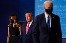 first lady Melania Trump, left, and President Donald Trump, center, remain on stage as Democratic presidential candidate former…