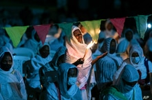 Ethiopian Orthodox Christians light candles and pray for peace during a church service at the Medhane Alem Cathedral in the…