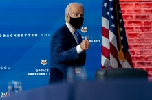 President-elect Joe Biden departs a news conference after introducing his nominees and appointees to economic policy posts at…