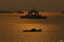 Cambodian fishermen on a motorized boat go fishing in the Mekong river in Phnom Penh, Cambodia, Tuesday, Feb. 2, 2021. (AP…
