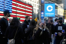 Coinbase employees gather outside the Nasdaq MarketSite during the company's IPO, in New York's Times Square, Wednesday, April…