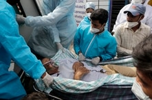 Health workers carry a patient after a fire in Vijay Vallabh COVID-19 hospital at Virar, near Mumbai, India, Friday, April 23,…