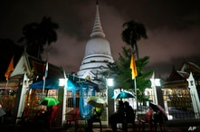 Locals wait in line overnight for free coronavirus testing at Wat Phra Si Mahathat temple in Bangkok, Thailand, Friday, July 9,…