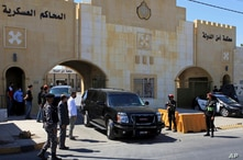 FILE - In this June 21, 2021 file photo, Bassem Awadallah, a former royal adviser, leaves a state security court in a vehicle…
