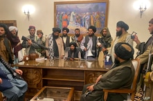 Taliban fighters take control of the Afghan presidential palace after President Ashraf Ghani fled the country, in Kabul,…