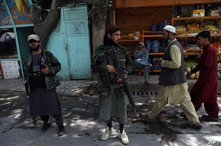 Taliban fighters stand guard at a checkpoint in the Wazir Akbar Khan neighborhood in the city of Kabul, Afghanistan, Sunday,…