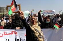 Afghan women shout slogans and wave Afghan national flags during an anti-Pakistan demonstration, near the Pakistan embassy in…
