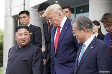 U.S. President Donald Trump, North Korean leader Kim Jong Un and South Korean President Moon Jae-in leave after a meeting at the demilitarized zone separating the two Koreas, in Panmunjom, South Korea, June 30, 2019.