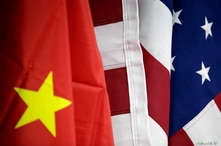 FILE - Flags of U.S. and China are displayed at AICC's booth during China International Fair for Trade in Services in Beijing.