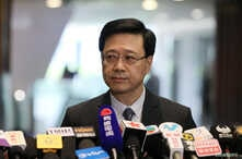 Secretary of Security John Lee Ka-Chiu announces the withdrawal of the extradition bill, in Hong Kong