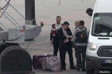 A still image taken from a video shows German Islamic State detainees, who are deported back to Germany, boarding a plane at…