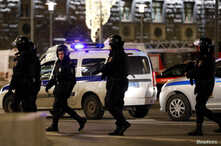 Police officers are seen near the Federal Security Service (FSB) building after a shooting incident, in Moscow, Russia December…