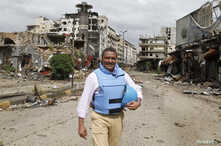 Yacoub El Hillo, a United Nations representative in Syria, reacts to the camera in old Homs city May 8, 2014. Syrian forces say…