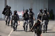 Thai security forces leave the Terminal 21 mall after completing their mission to stop a soldier on a rampage after a mass…