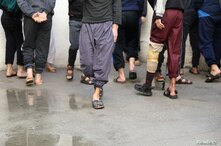 Prisoners from Iraq and Syria, suspected of being part of the Islamic State, spend time in the prison's grounds in Hasaka,…