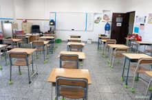An empty classroom is seen in a private school in Hawally, after the Ministry of Education suspended schools and universities…