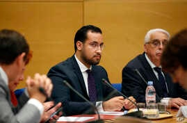 Former President Macron's security aide Alexandre Benalla appears before the French Senate Laws Commission prior to his hearing, in Paris, Sept. 19, 2018.