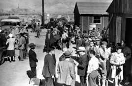 FILE - The first arrivals at the Japanese evacuee community established in Owens Valley in Manzanar, Calif., part of a vanguard of workers from Los Angeles, March 23, 1942. Roughly 120,000 Japanese immigrants and Japanese-Americans were sent to camps