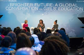 "First lady Michelle Obama, flanked by actress Yara Shahidi (R) and Glamour Magazine Editor in Chief  Cindi Leive, participates in Glamour's ""A Brighter Future: A Global Conversation on Girls' Education,"" in celebration of International Day of the Gir"